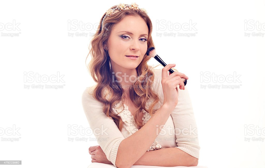 The woman the makeup artist with a brush for powder stock photo