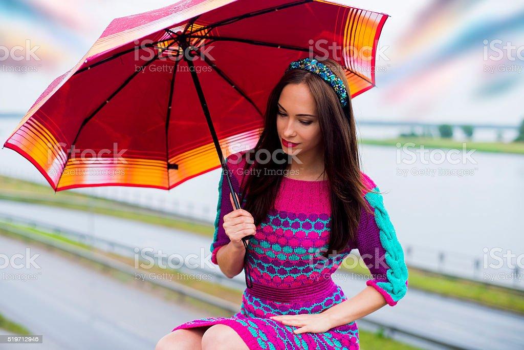 The woman under an umbrella stock photo