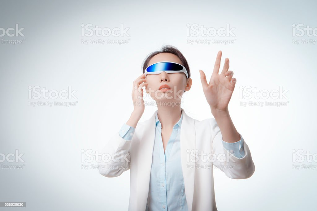 The woman wearing VR glasses. stock photo