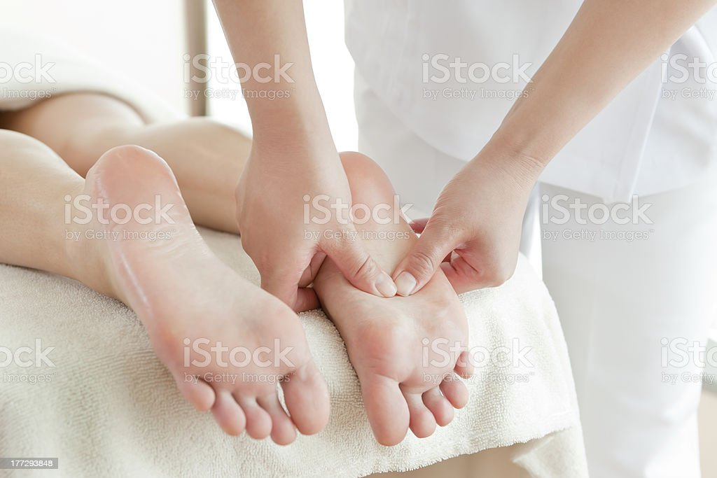 The woman who receives a beauty treatment salon stock photo