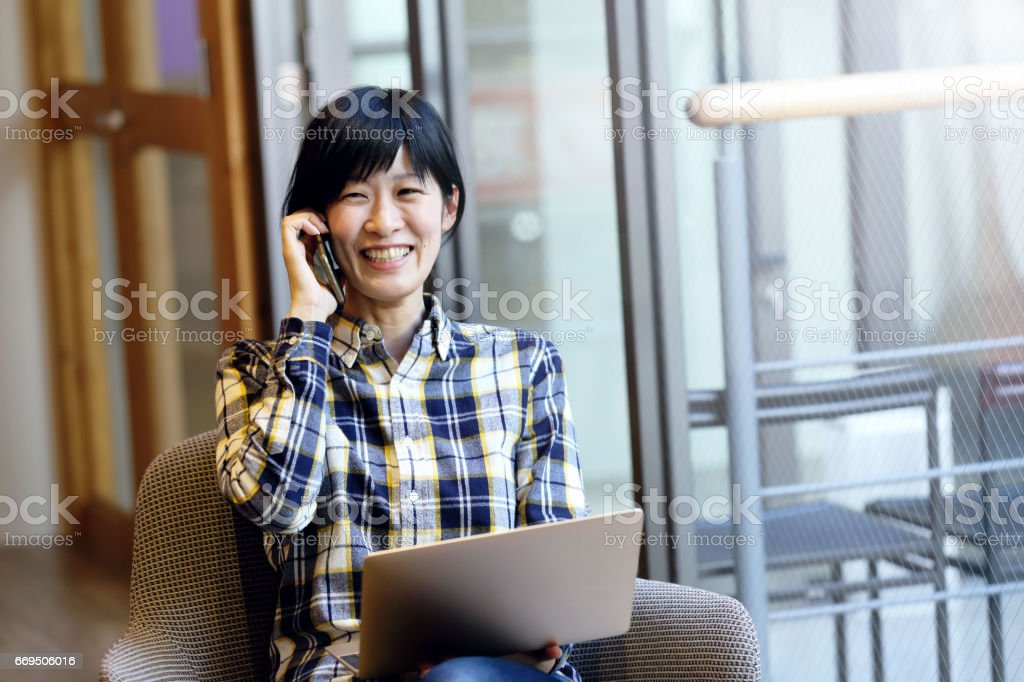 The woman who works with a smile stock photo