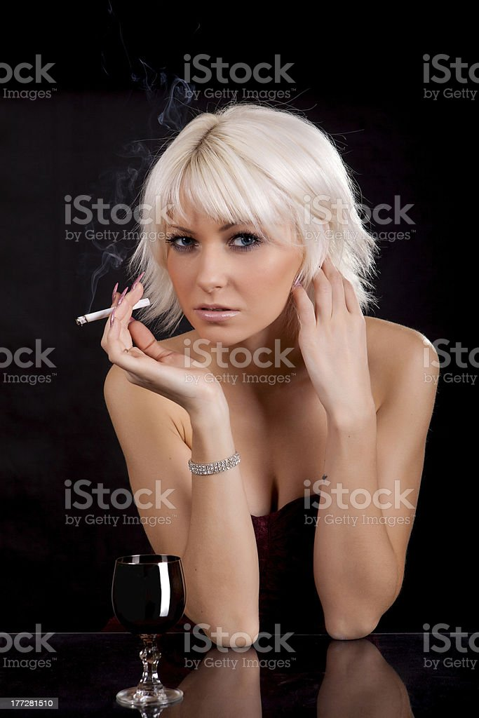 The woman with a cigaret royalty-free stock photo