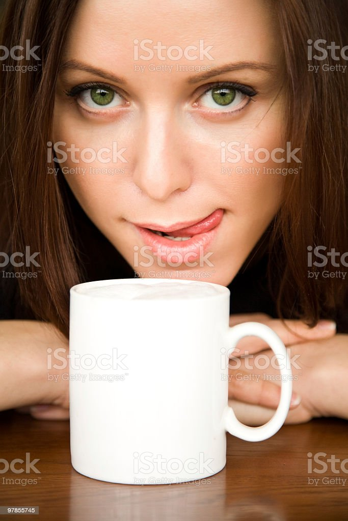 The woman with a coffee cup royalty-free stock photo