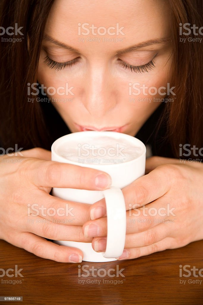 The woman with a coffee cup stock photo