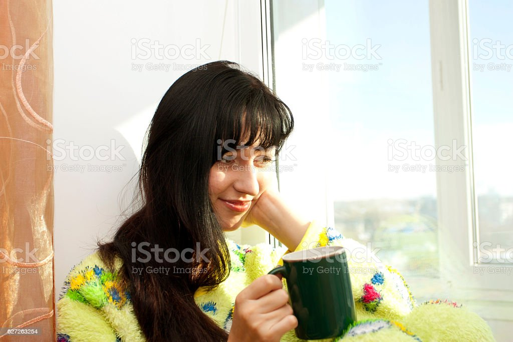 The woman with a cup of coffee stock photo