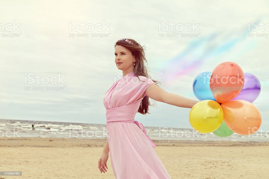The woman with balloons and wings stock photo