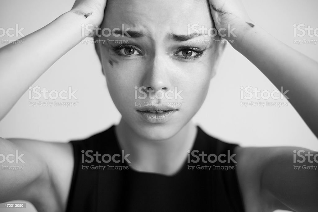 The woman with running mascara stock photo
