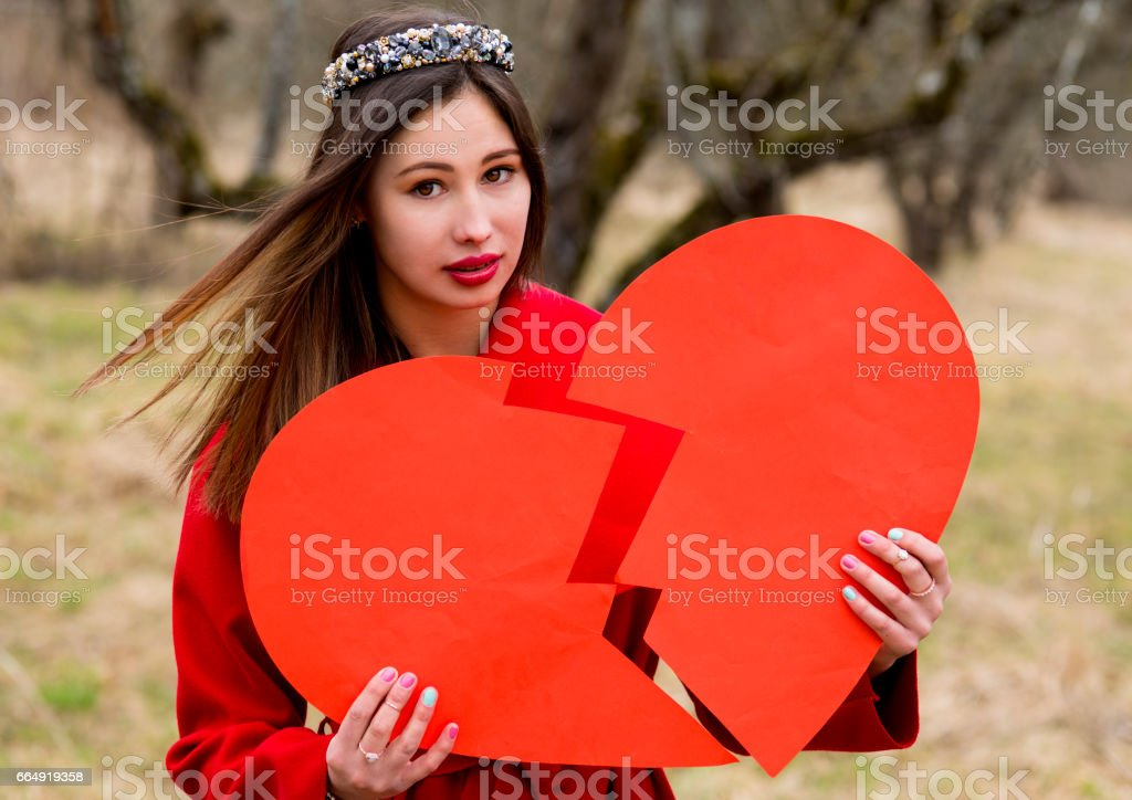 The woman with the broken heart stock photo