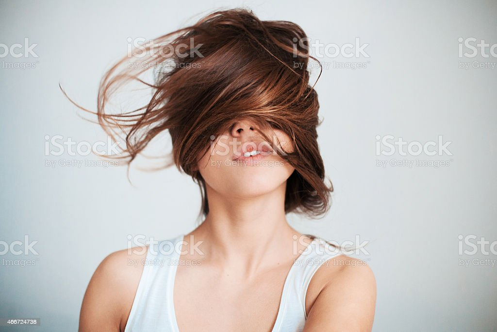 The woman's face half closed by hair stock photo