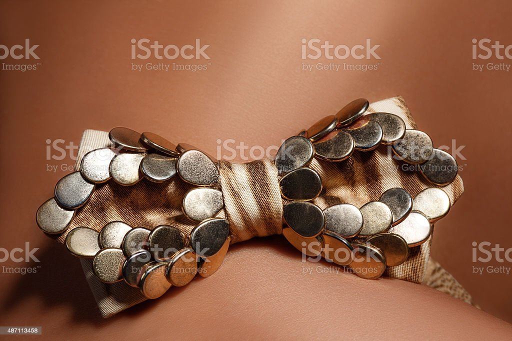 The women's body with a bow tie stock photo
