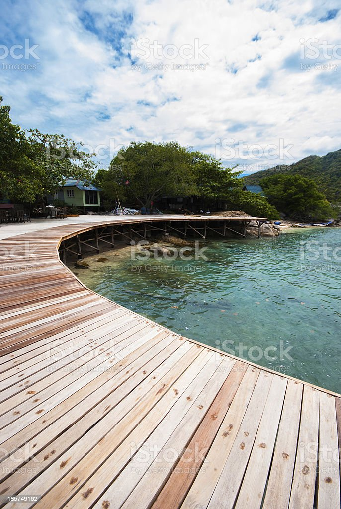 The wooden bridge at a beautiful beach royalty-free stock photo