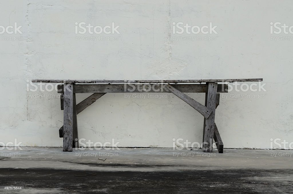 The wooden chair agalnst old white wall. stock photo