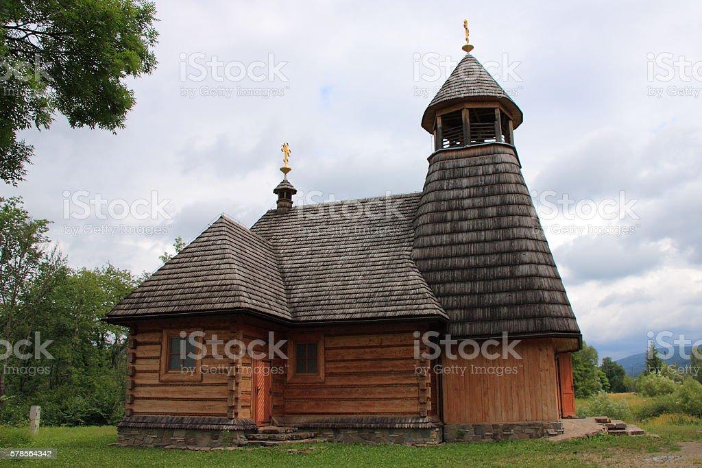The wooden church in Wola Michowa (Bieszczady, Poland) stock photo