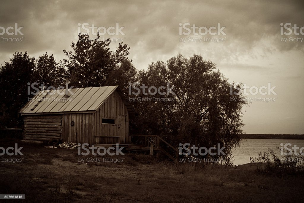 the wooden house at the river stock photo