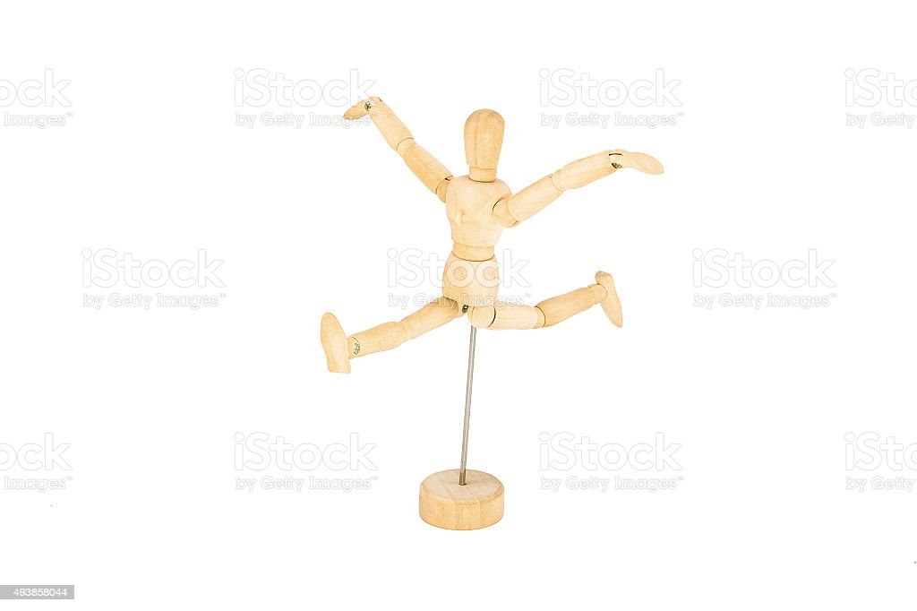 The wooden mannequin jumps with the hands lifted upwards isolate stock photo