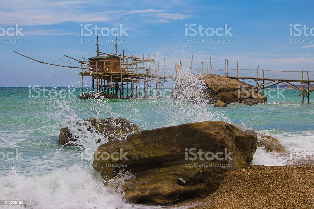 The wooden palafitte in the sunrise of the Mediterranean sea stock photo