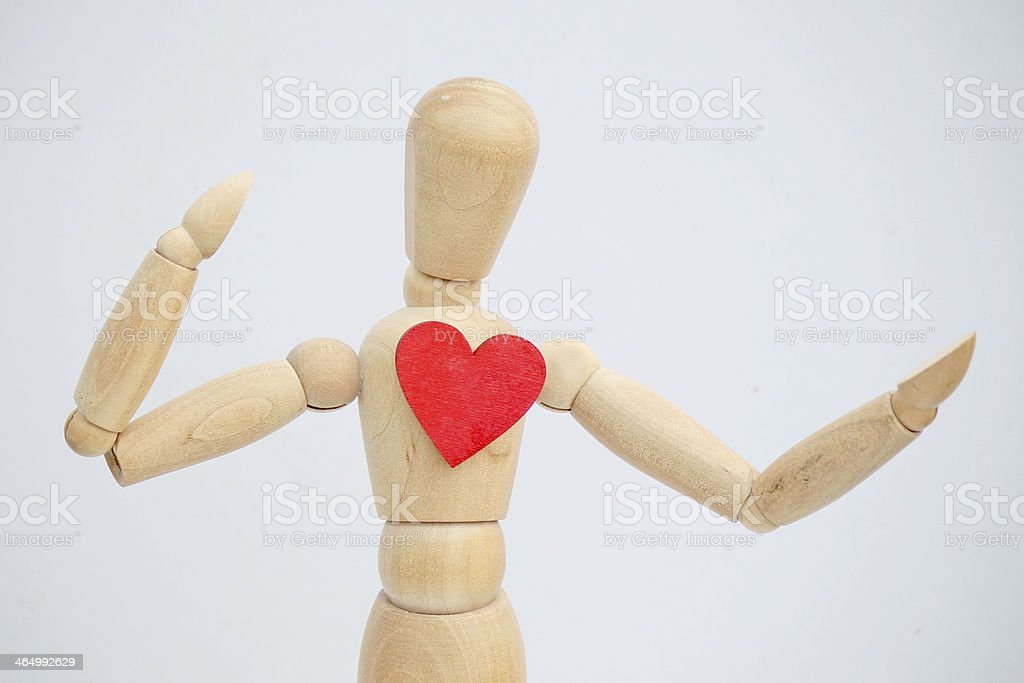 The wooden puppet and red heart royalty-free stock photo