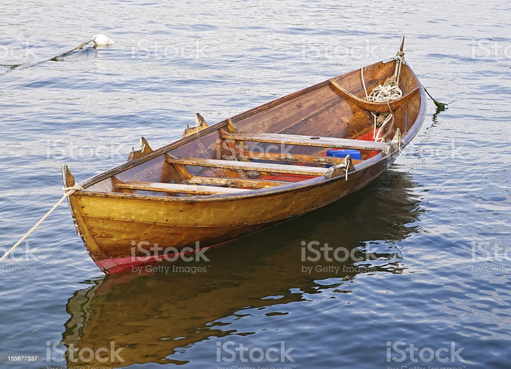 The wooden rowing and sailing boat royalty-free stock photo