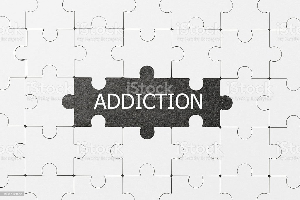 The word Addiction revealed missing piece in a jigsaw puzzle stock photo