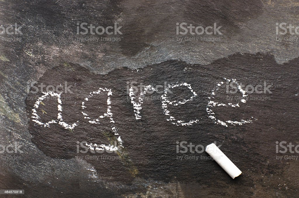 The word agree written with chalk on black stone. stock photo