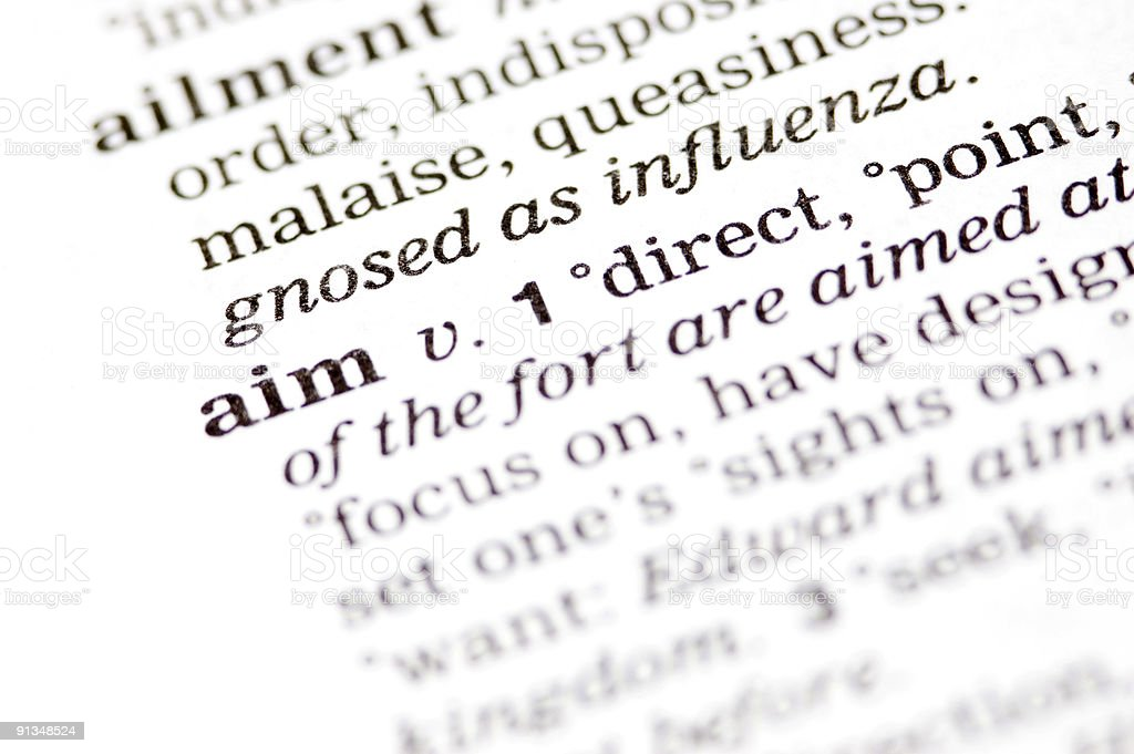 The word aim written in a thesaurus royalty-free stock photo
