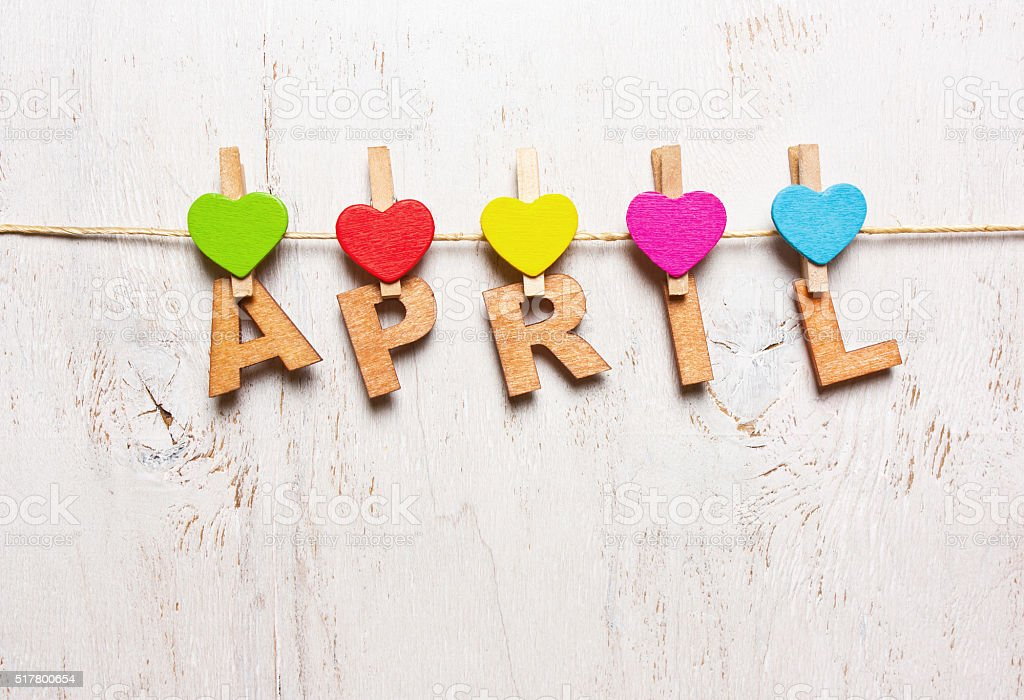 the word 'april' from the wooden letters stock photo