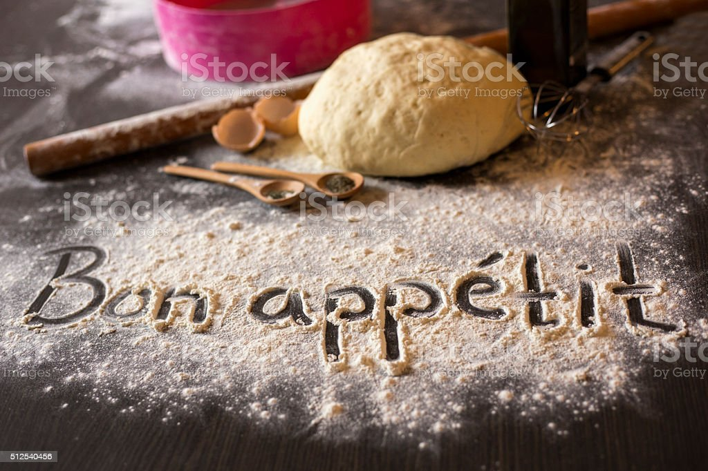 The word Bon appetit written in flour stock photo