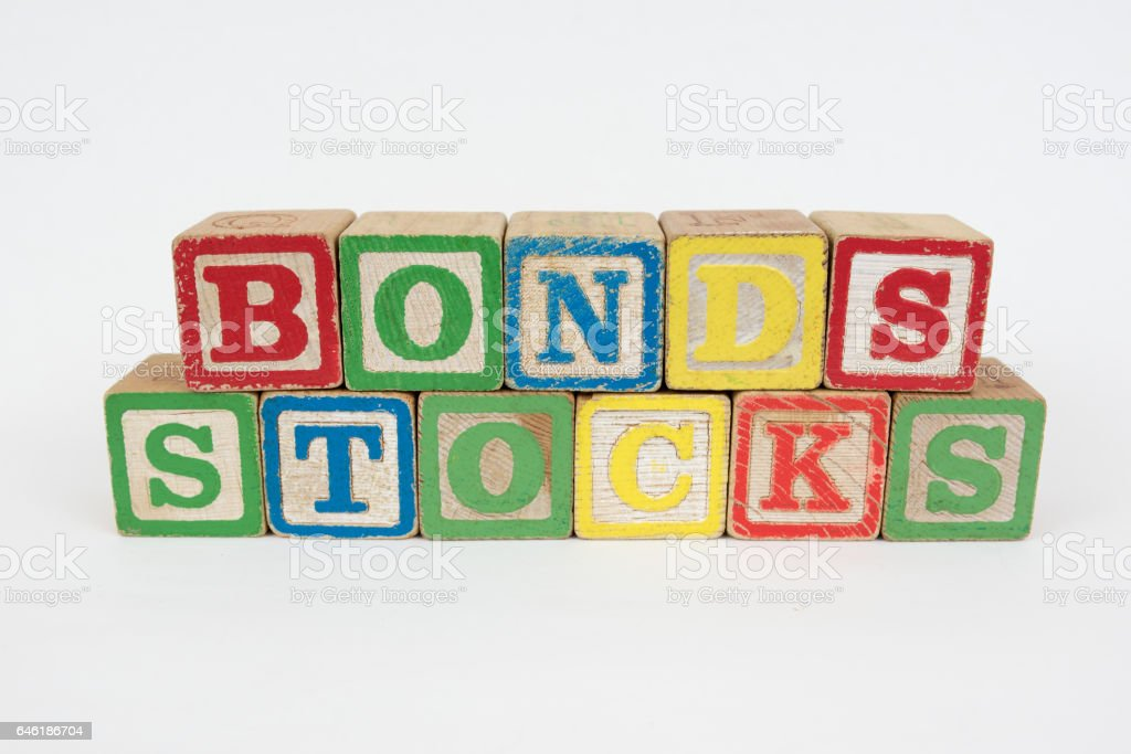The Word Bonds and Stocks in Wooden Childrens Blocks stock photo