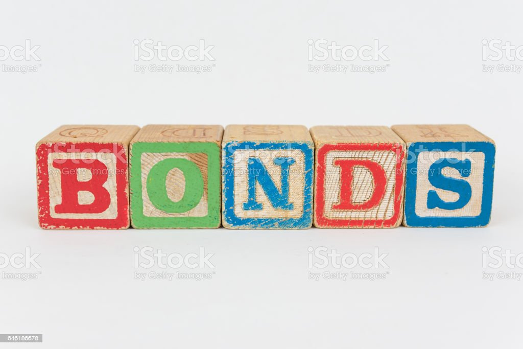 The Word Bonds in Wooden Childrens Blocks stock photo