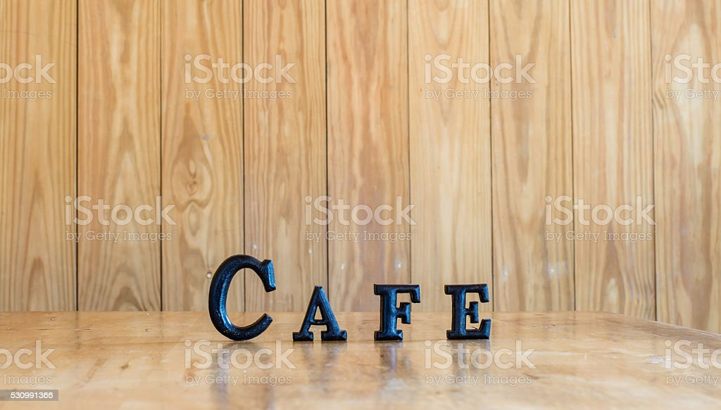 the word CAFE wooden letters on wood stock photo