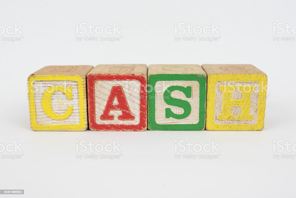 The Word Cash in Wooden Childrens Blocks stock photo