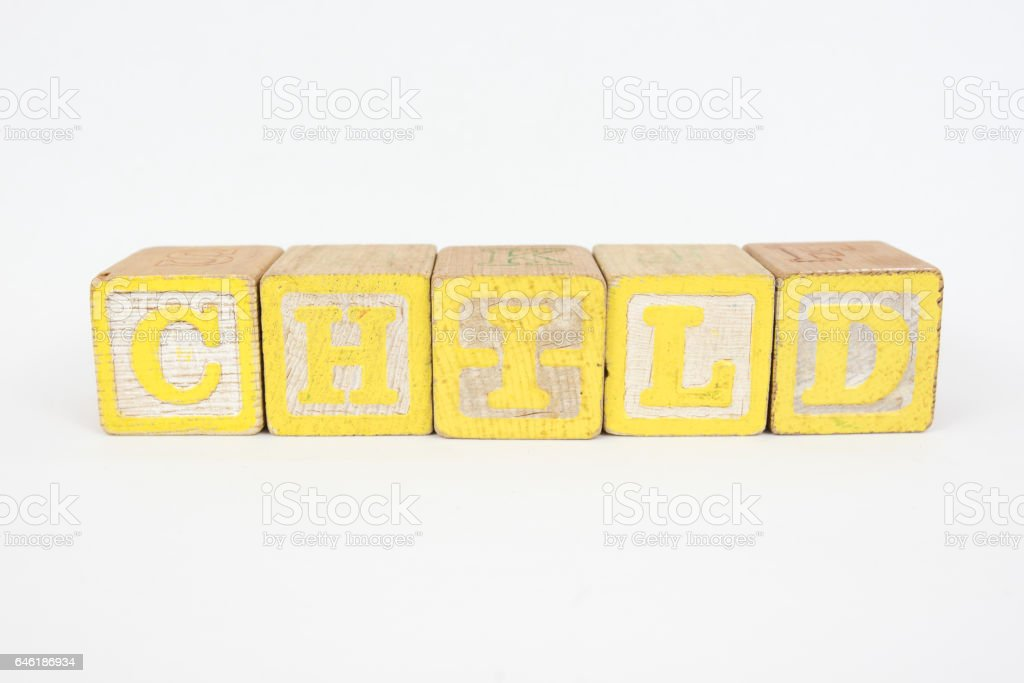 The Word Child in Wooden Childrens Blocks stock photo