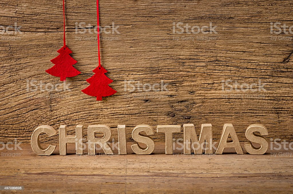 The word christmas in front of a rustic background stock photo