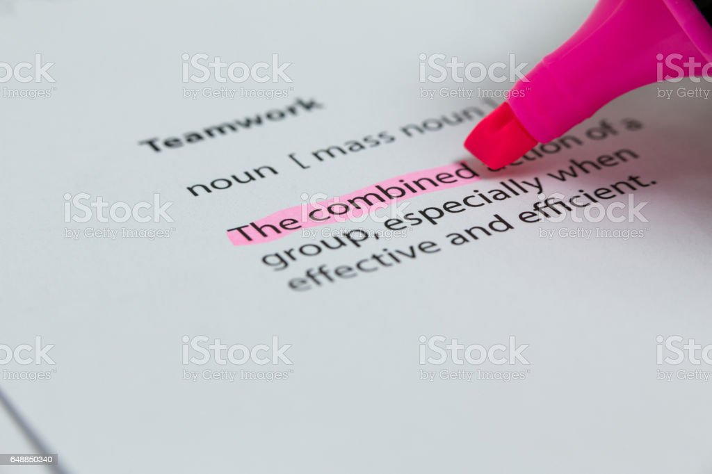 The word combined highlighted in pink with felt tip pen stock photo