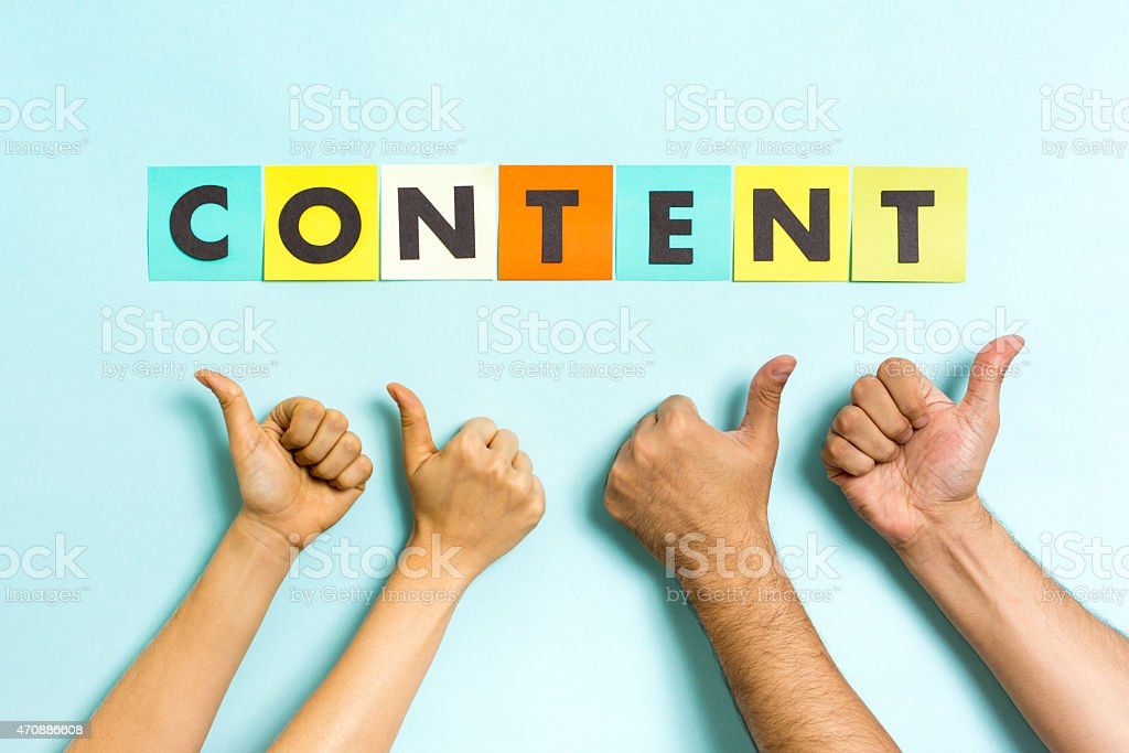 The word 'content' with four hands making thumbs up gesture. stock photo