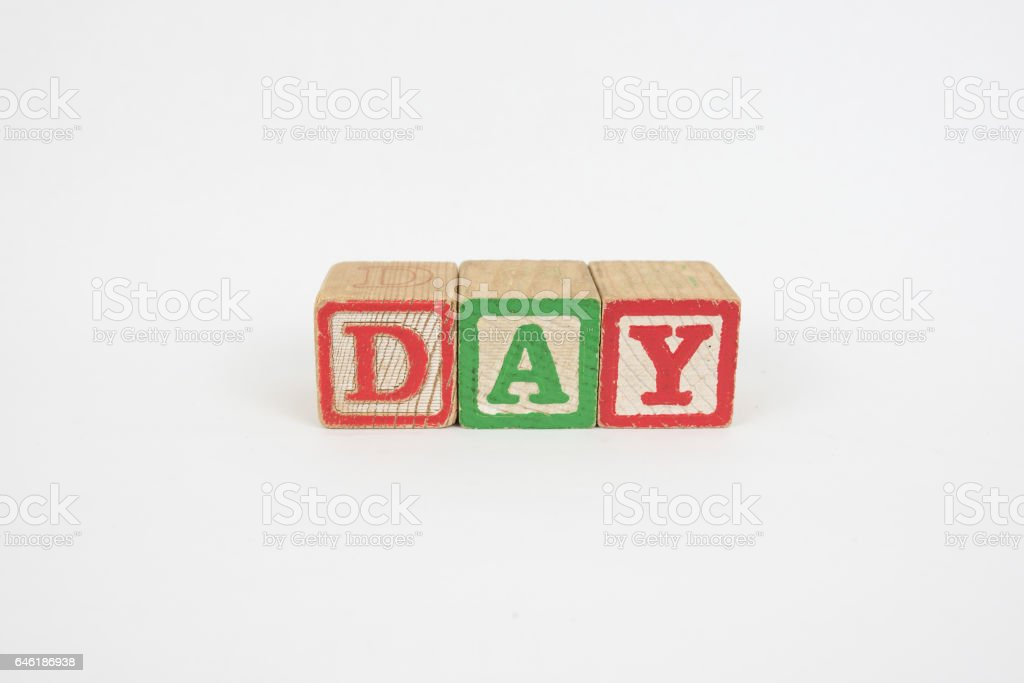 The Word Day in Wooden Childrens Blocks stock photo