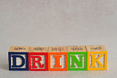 The word drink spelled with alphabet blocks