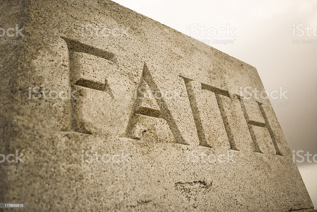 The word faith inscribed in granite royalty-free stock photo