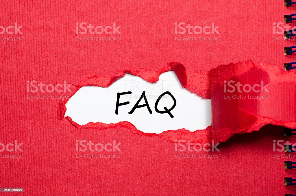 The word faq appearing behind torn paper stock photo