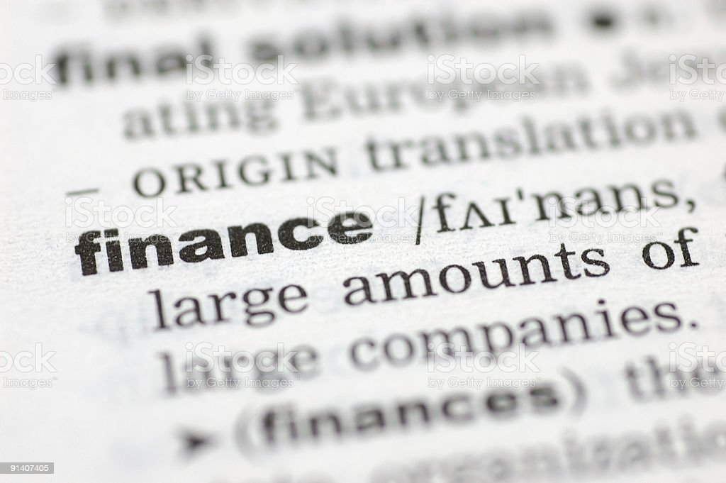 The word finance defined on paper stock photo