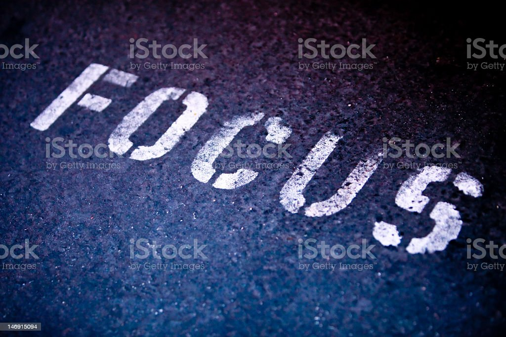 The word focus spray painted onto the black ground royalty-free stock photo