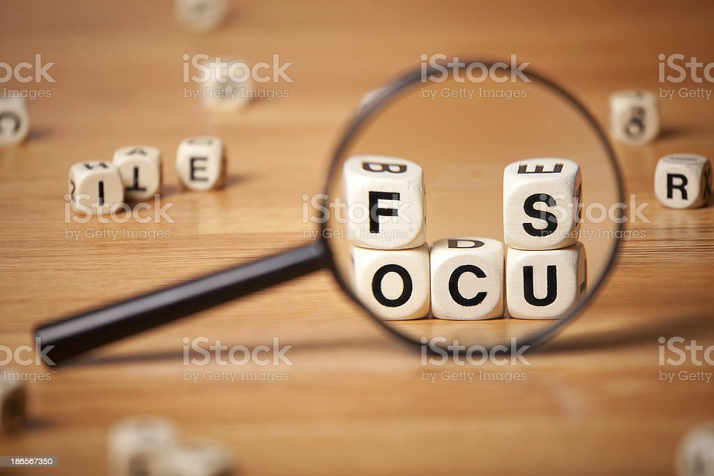 The Word Focus Though Magnifying Glass stock photo