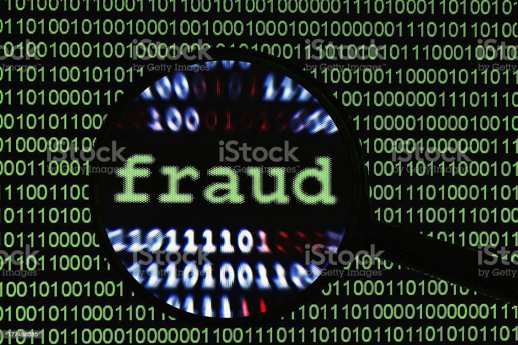 The word Fraud found and magnified among binary codes royalty-free stock photo