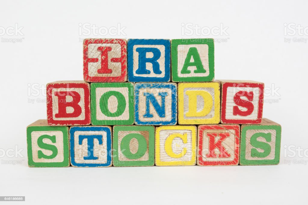 The Word IRA, Bonds and Stocks in Wooden Childrens Blocks stock photo