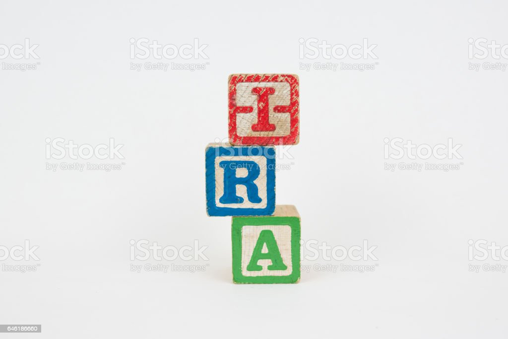 The Word IRA in Wooden Childrens Blocks stock photo