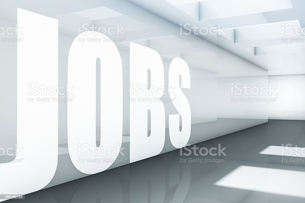 The word JOBS in white on a semi-transparent wall background stock photo