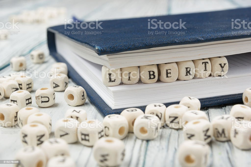 The word Liberty written wood block. Wooden ABC stock photo