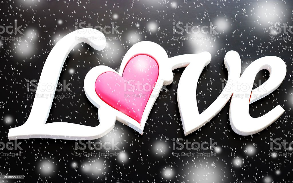 The word love on a black background stock photo