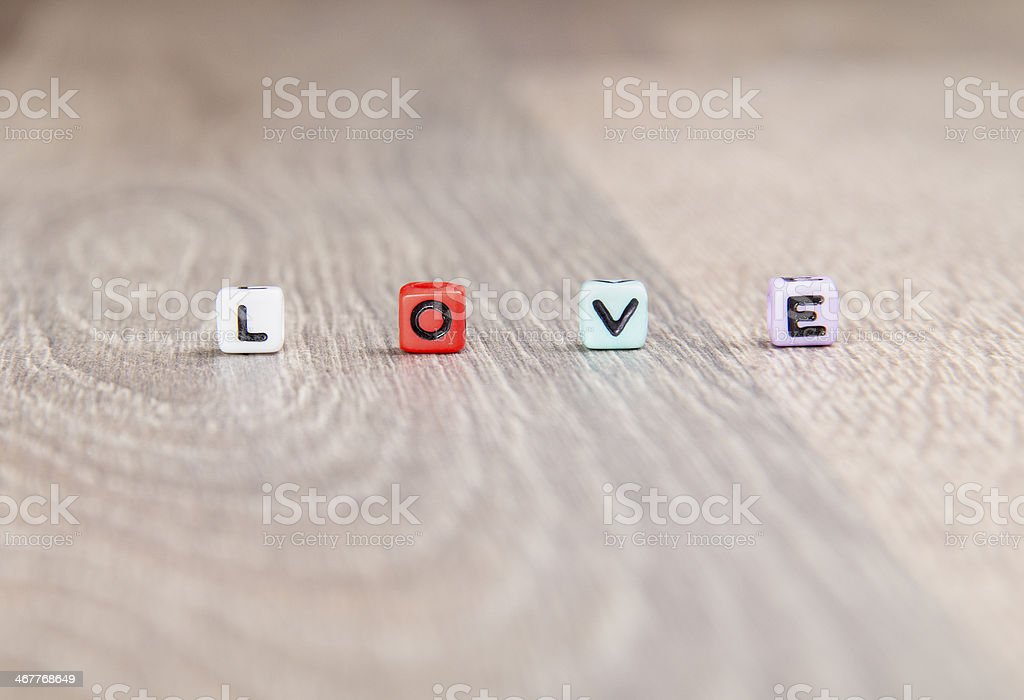 the word love on a wooden surface royalty-free stock photo