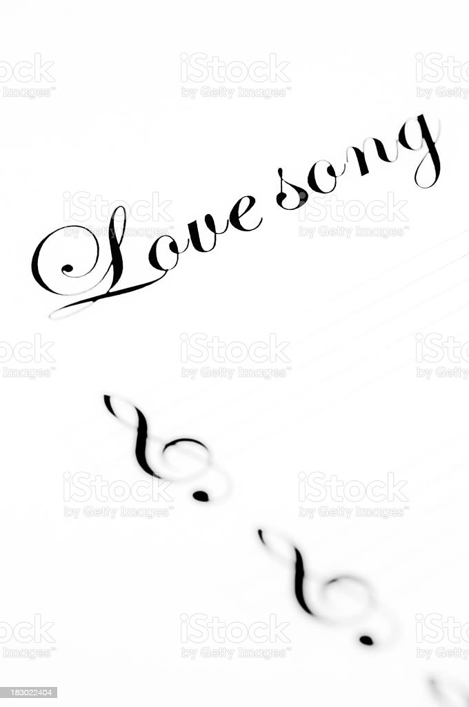 the word love song written on a music sheet royalty-free stock photo